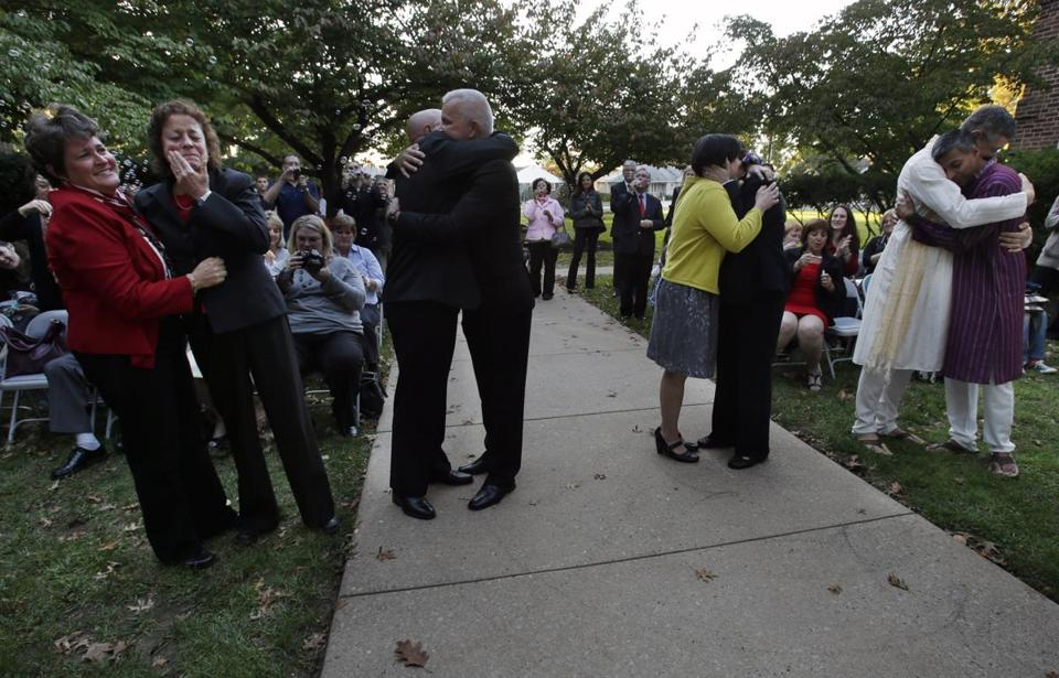 Four couples hugged after they were declared married by Mayor Chuck Cahn in Cherry Hill, N.J., on Monday, the first day same-sex marriages were legal in the state.