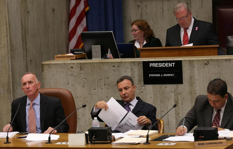 From left, City Councilors Bill Linehan, Sal LaMattina, and Rob Consalvo listened during Wednesday's hearing.