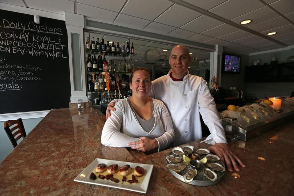 Owners Megan and Joseph Emma at Oysters Bar & Grille in Pembroke, with some of their signature plates.