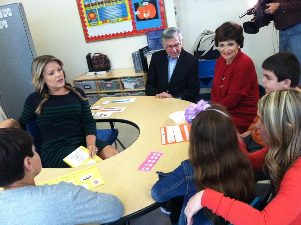 Michael and Kitty Dukakis joined teacher Lauren Arumeni (left) in a classroom visit last month at the New England Center for Children in Southborough.