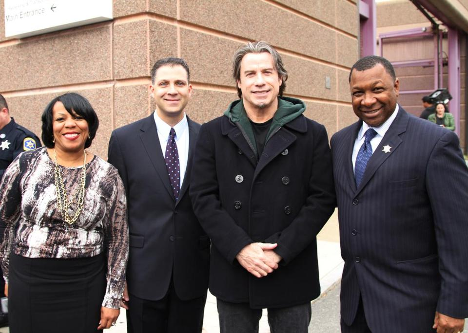 John Travolta (second from right) posed with House of Correction Superintendent Yolanda Smith, state Senator Anthony Petruccelli, and Suffolk County Sheriff Steven W. Tompkins.