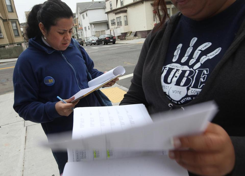 Astrid Osorio (left) and a colleague canvass East Boston on Wednesday to get out the vote for the Nov. 5 referendum.