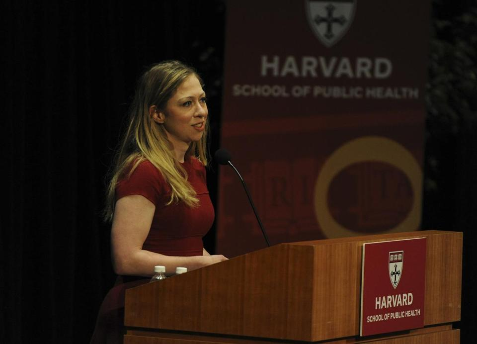 Chelsea Clinton was honored with the Harvard School of Public Health's Next Generation Award for her work on health programs for the Clinton Foundation. Her father received the school's Centennial Medal.