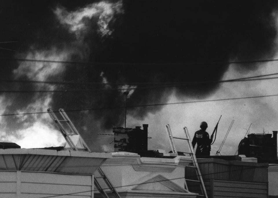 "Police on a roof as fire rages in documentary ""Let the Fire Burn,"" about the 1985 assault on the separatist urban commune MOVE."