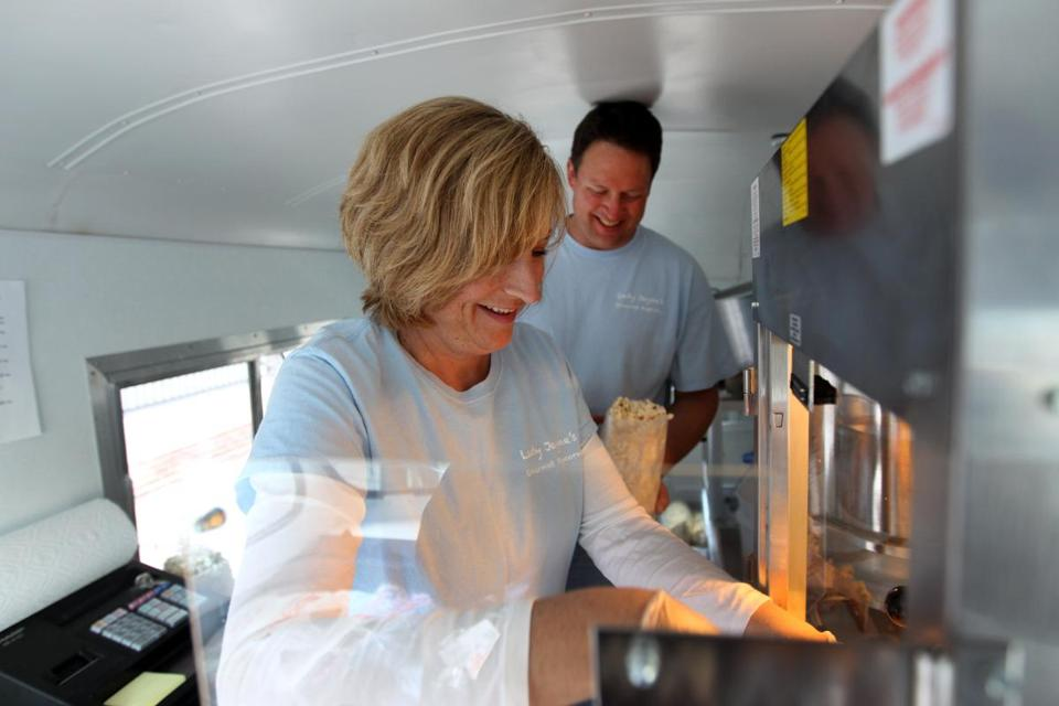 "Jo-Anne and Scott Gibson have gone from selling their Lady Jayne's Gourmet Popcorn from a cart in downtown Andover to joining ""the mobile food craze"" with a restored 1957 International Metro Van."