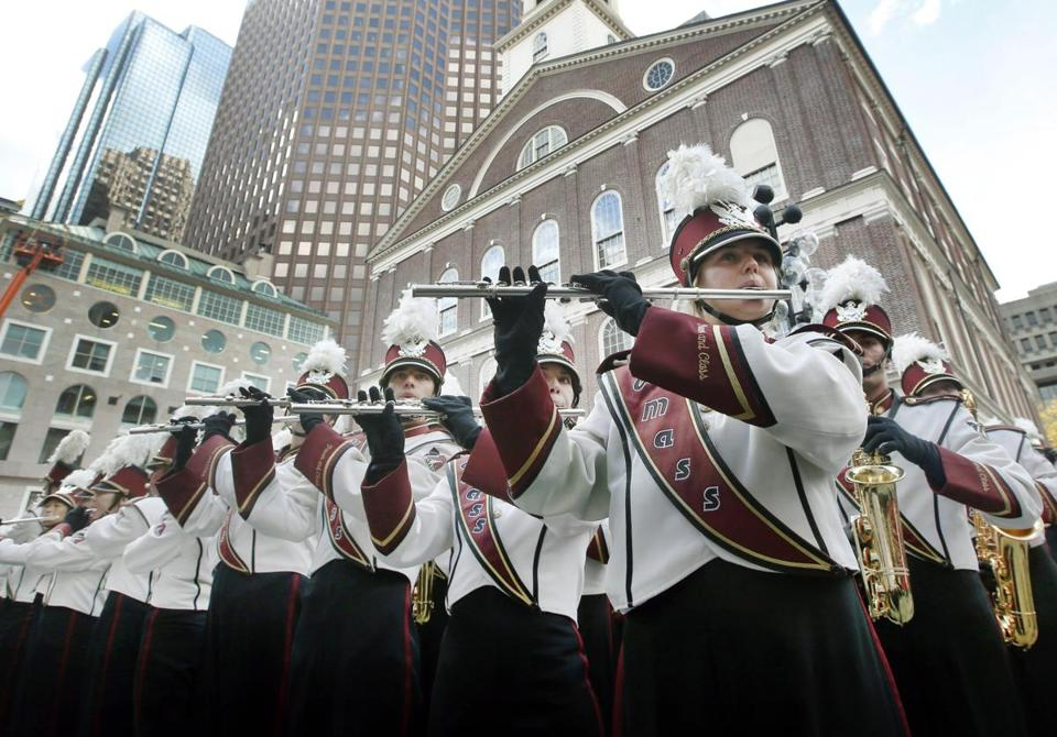 Members of the University of Massachusetts-Amherst marching band play during a pep rally outside Faneuil Hall in Boston on Friday Oct. 25, 2013.