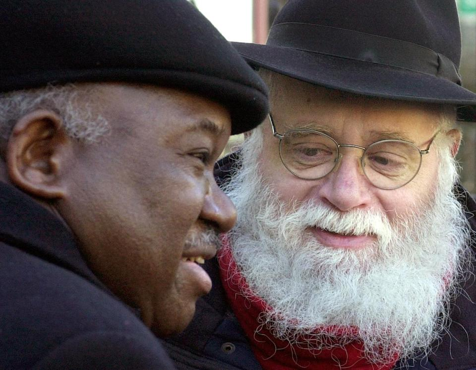 Community leaders in the Crown Heights section of Brooklyn, Major R. Owens and Ben-Tzion Meltzer, in 2002.