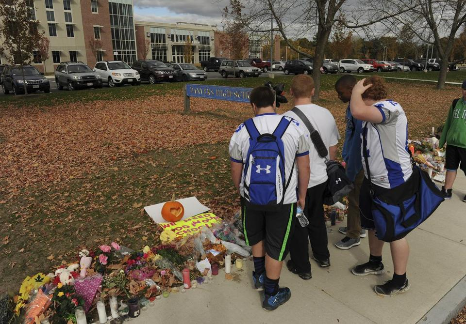 Students walked in front of a make-shift memorial at Danvers High School.