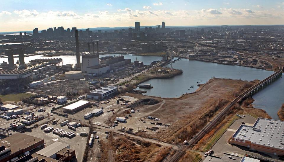 An aerial view of the Everett site where a casino is planned. The view also shows the Mystic River, with Charlestown and Somerville on the other side of the river.
