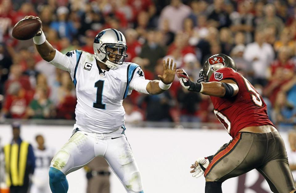 Panthers quarterback Cam Newton dodged Daniel Te'o-Nesheim in first-half action Thursday.