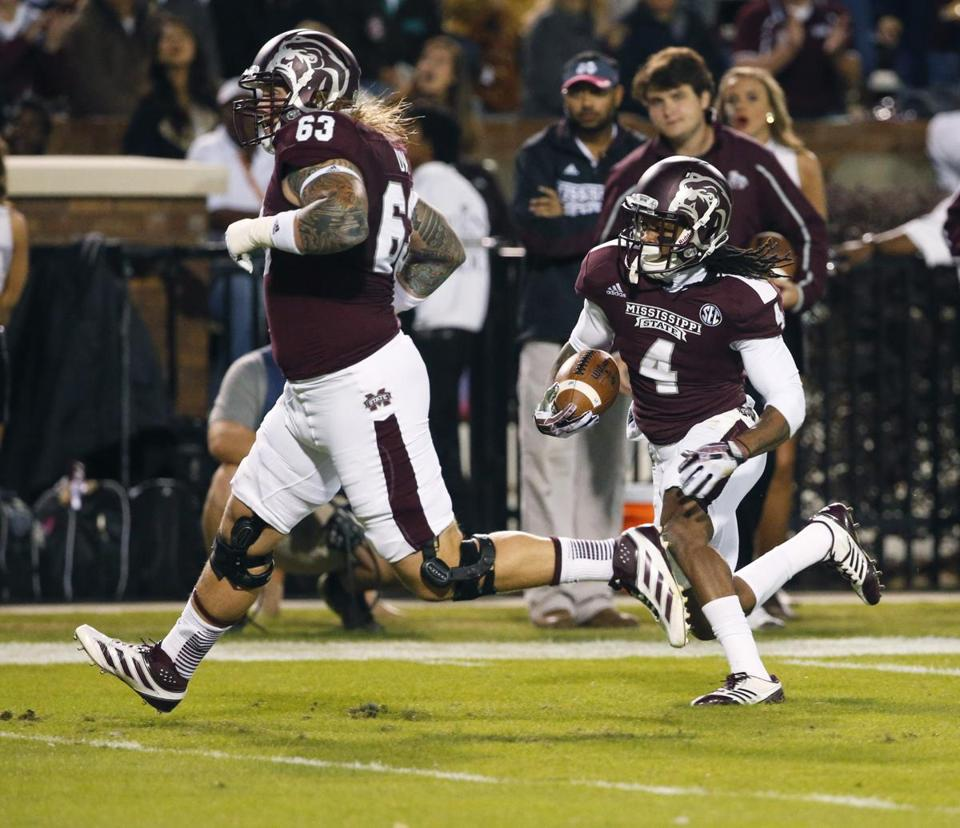 Mississippi State's Jameon Lewis has company on his 19-yard TD run in the first quarter.