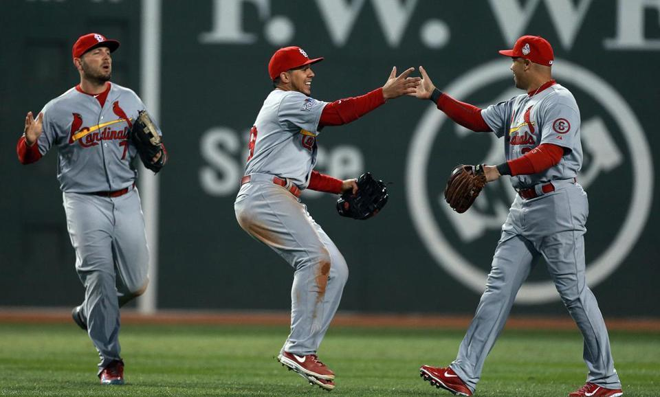Outfielders Matt Holliday, Jon Jay, and Carlos Beltran celebrated the Cardinals' 4-2 victory over the Red Sox in Game 2 of the World Series.