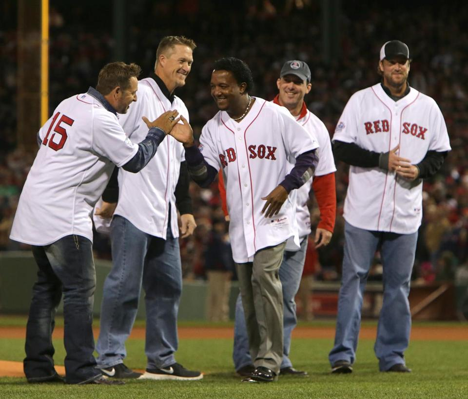 Among the 2004 champions on hand to pitch in before Game 2 were (from left) Kevin Millar, Mike Timlin, Pedro Martinez, Trot Nixon, and Derek Lowe.