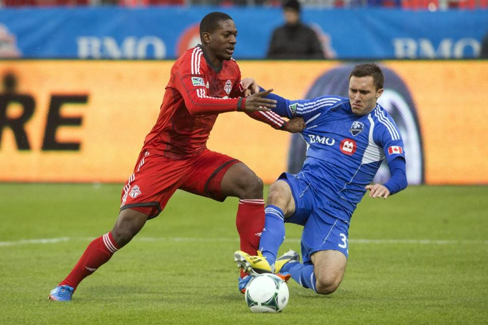 Toronto's Doneil Henry (left) battles Andrew Wenger during the first half of both teams' regular-season finale.