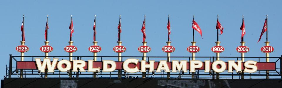 Five of the Cardinals' 11 championship banners are shown over Busch Stadium.