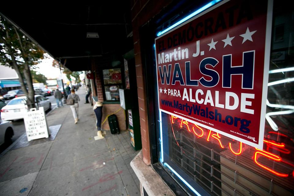 A bilingual Walsh campaign sign hung Thursday in a storefront on Washington Street in Egleston Square.  Walsh says the area has challenges that he could address as mayor.