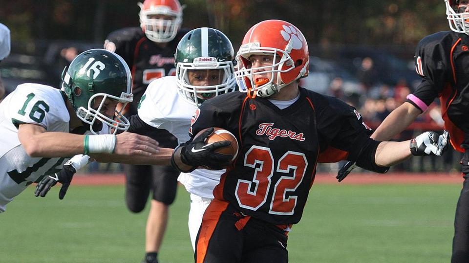 Oliver Ames running back Matthew Berksza eludes a pair of Canton defenders Saturday en route to the team's 41-13 win.