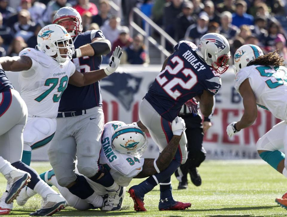 Patriots tackle Sebastian Vollmer suffers a broken right leg when he is rolled into while blocking on a Stevan Ridley run.