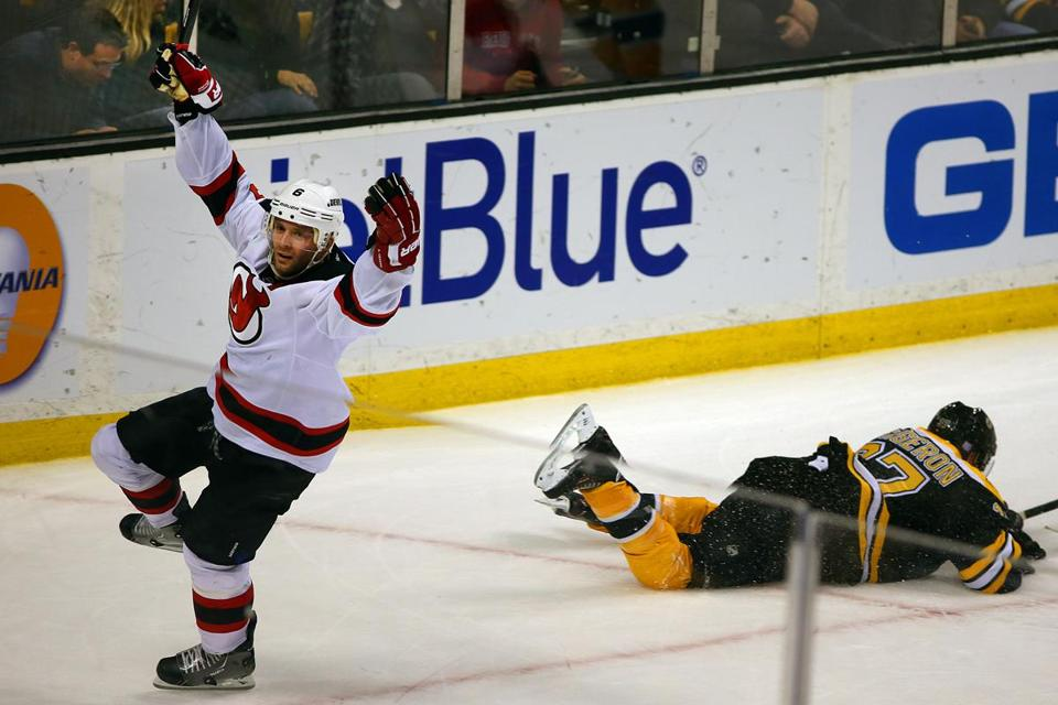 With Patrice Bergeron down, Andy Greene celebrates his winning goal.