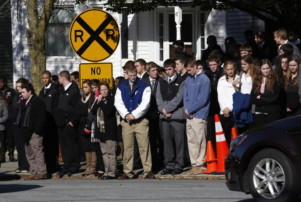 Students lined the streets outside St. Augustine Church following the funeral of teacher Colleen Ritzer on Monday.