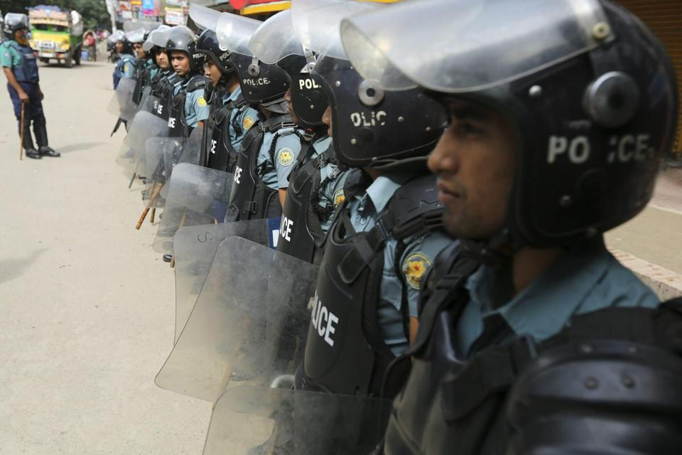 Security officials stood guard in Dhaka, Bangladesh, on Sunday during the first day of a 60-hour national strike.
