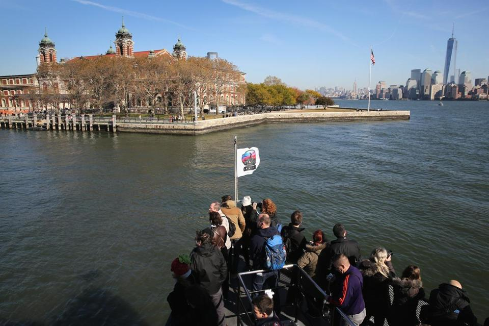 A boat carried tourists to Ellis Island on Monday, after the monument to the nation's immigrants reopened.
