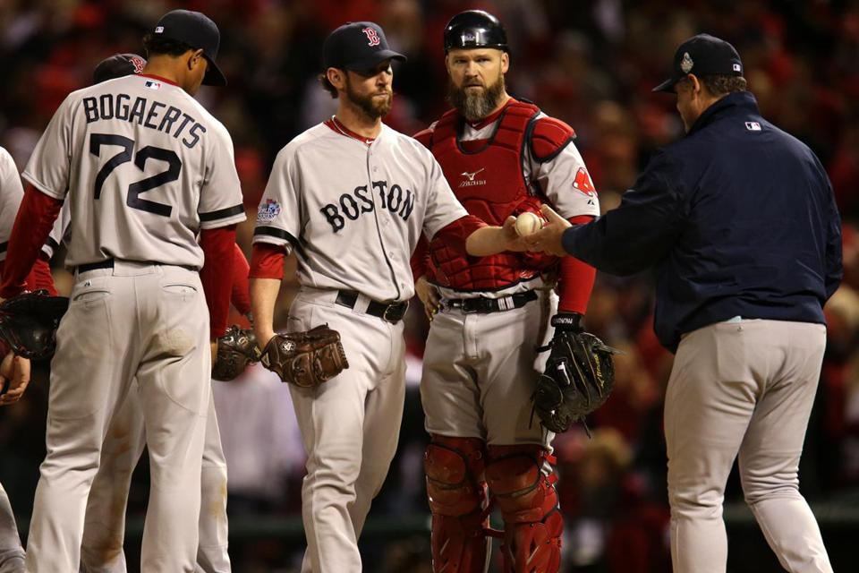 Craig Breslow hands the ball to Red Sox manager John Farrell after his ineffective performance in the seventh.