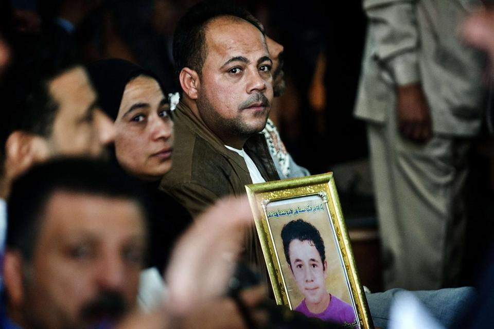 Setohy Abdel Rahman held a portrait of his son Ahmed, killed during clashes, at a trial of Muslim Brotherhood leaders.