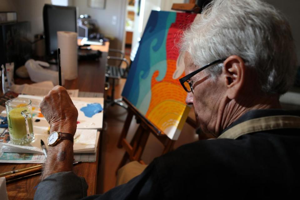 Ron Emmerling, in his Newburyport home, works on one of his paintings.
