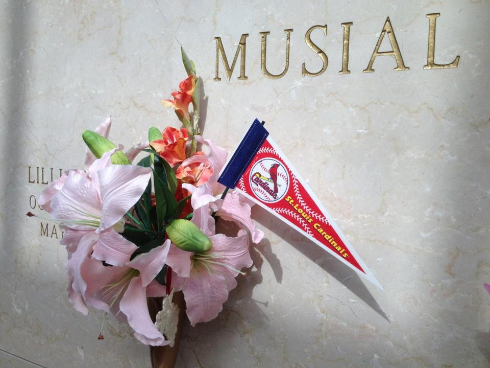 Fans often leave tributes at the burial site of former Cardinals great Stan Musial.