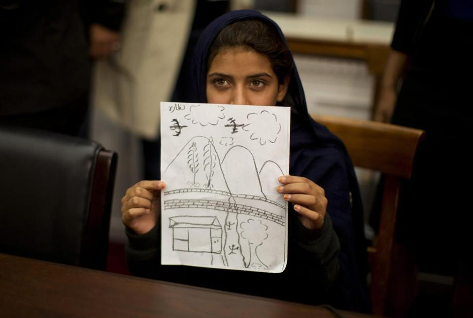 At a Capitol Hill news conference Tuesday, 9-year-old Nabila Rehman displayed a picture she drew depicting the US drone strike on her Pakistan village that killed her grandmother.