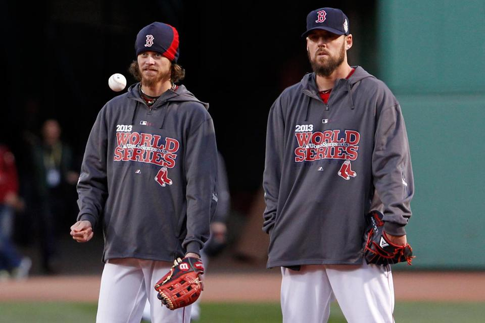 Clay Buchholz (left) and John Lackey, Wednesday night's Game 6 starter, look on during batting practice Tuesday.