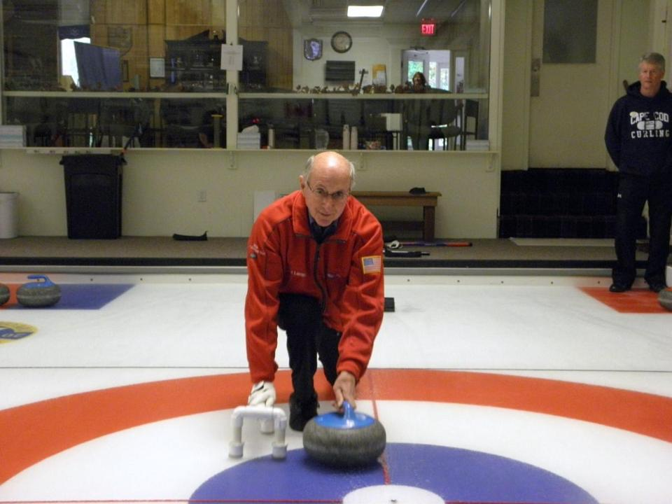 Cape Cod Curling member Russ Lemcke sends the stone on its way.
