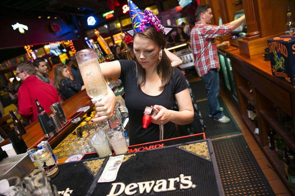 Meade Sparks made drinks on Halloween at Allston's White Horse Tavern, which will be open for an extra hour Sunday morning.