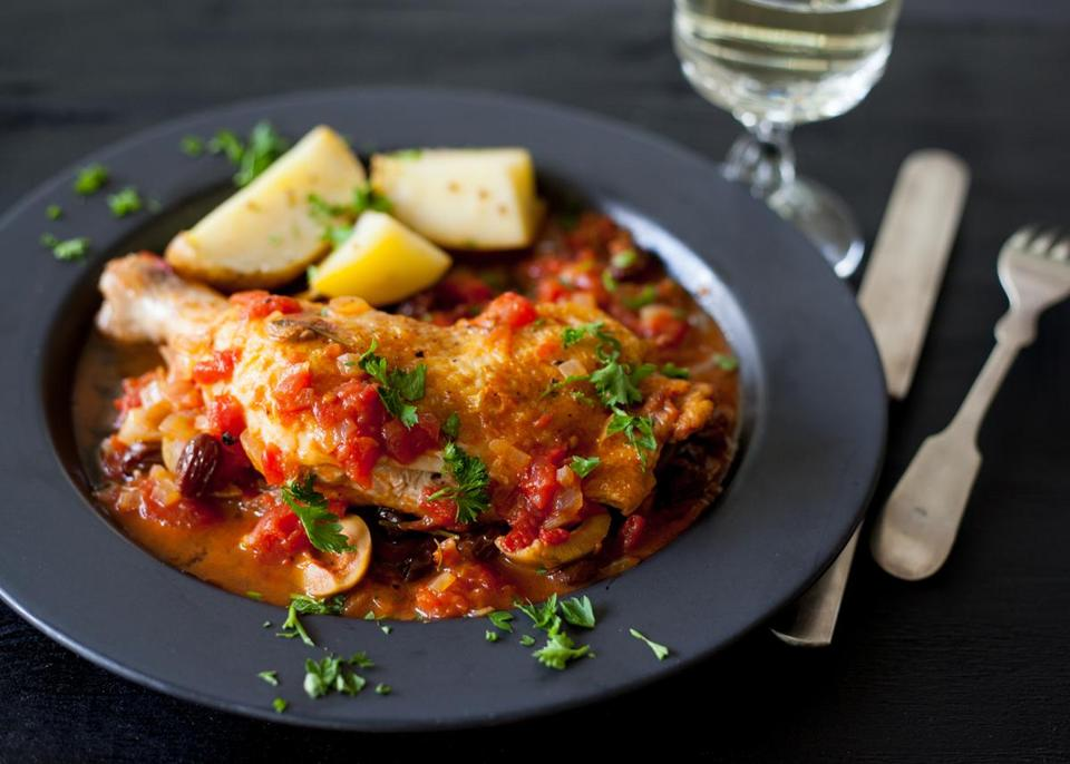 Braised chicken with tomatoes and olives.