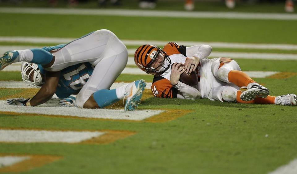Bengals QB Andy Dalton is slammed to the end zone turf by Cameron Wake in overtime.