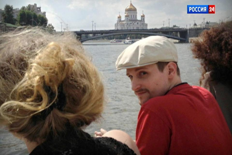 NSA leaker Edward Snowden was seen on a boat trip in Moscow in a frame from a video reportedly shot in September.