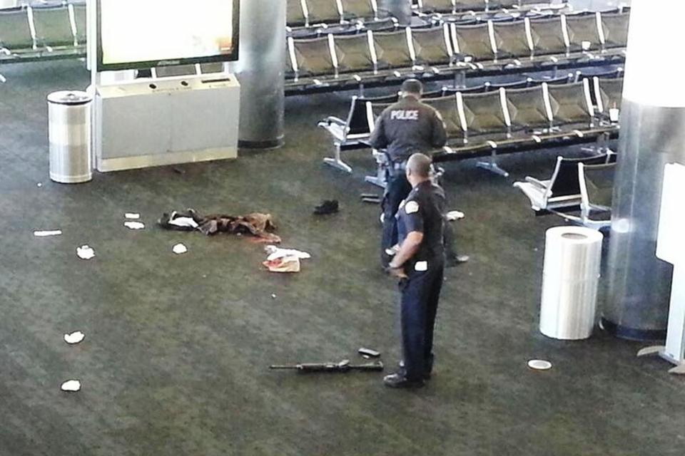 Police stood near an unidentified weapon in Los Angeles International Airport Friday.