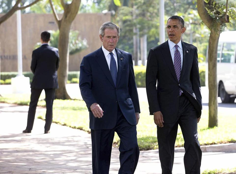 Former President George W. Bush and President Obama at the US Embassy in Tanzania in July.