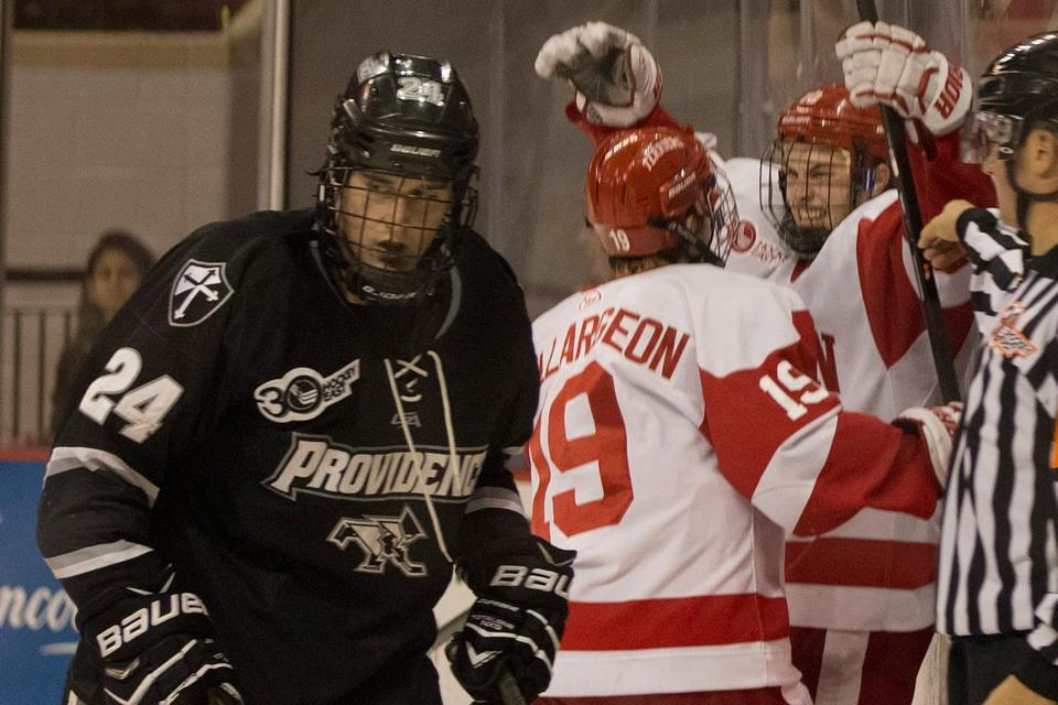 BU's Danny O'Regan (far right) celebrates with Robbie Baillargeon after O'Regan scored the winner 5:38 into the third period.
