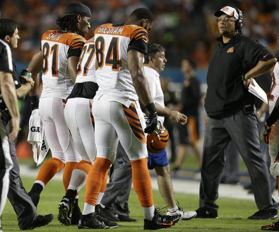 All-Pro defensive tackle Geno Atkins (97) was helped off the field after tearing an ACL Thursday.