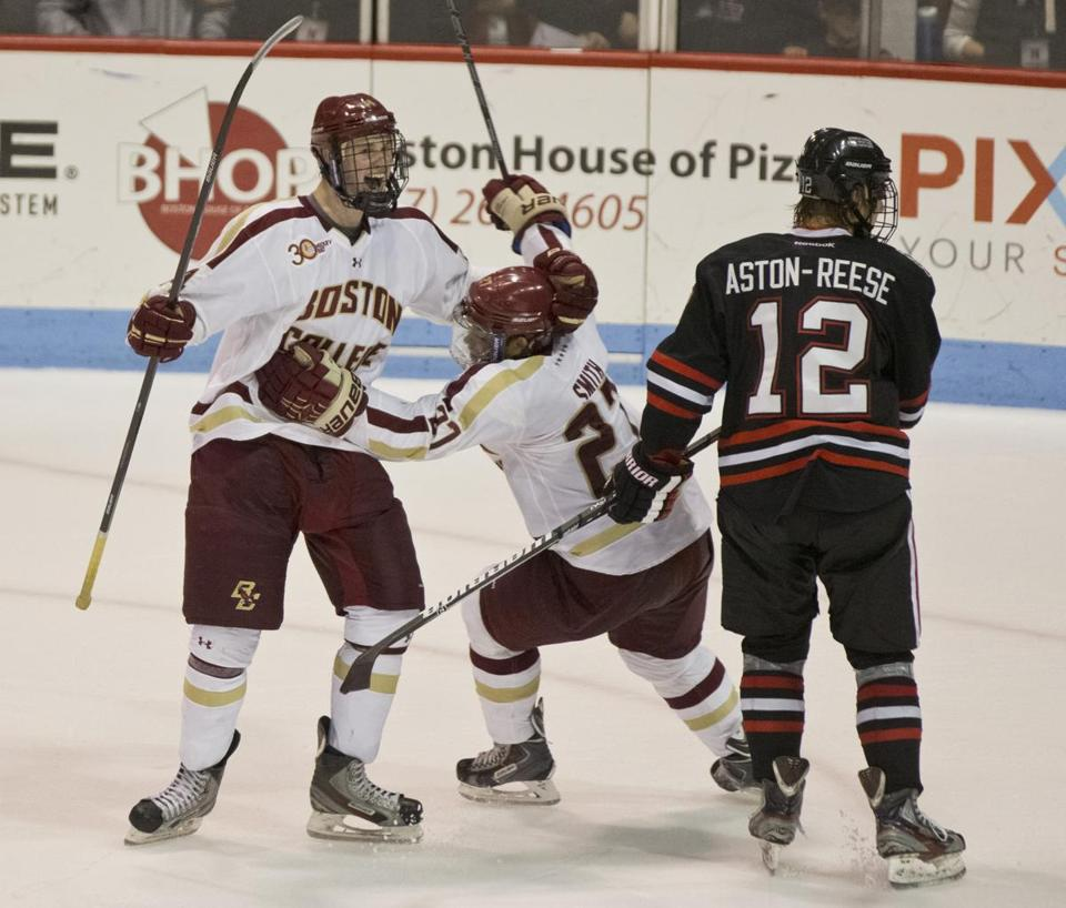 Adam Gilmour (left) celebrates his overtime goal with BC teammate Quinn Smith, who assisted on the strike.