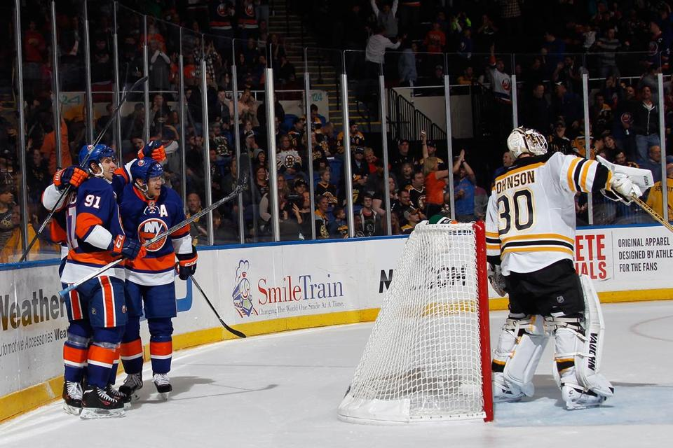The Bruins' Chad Johnson ignores the Islander party behind him after Thomas Vanek's goal in the second.