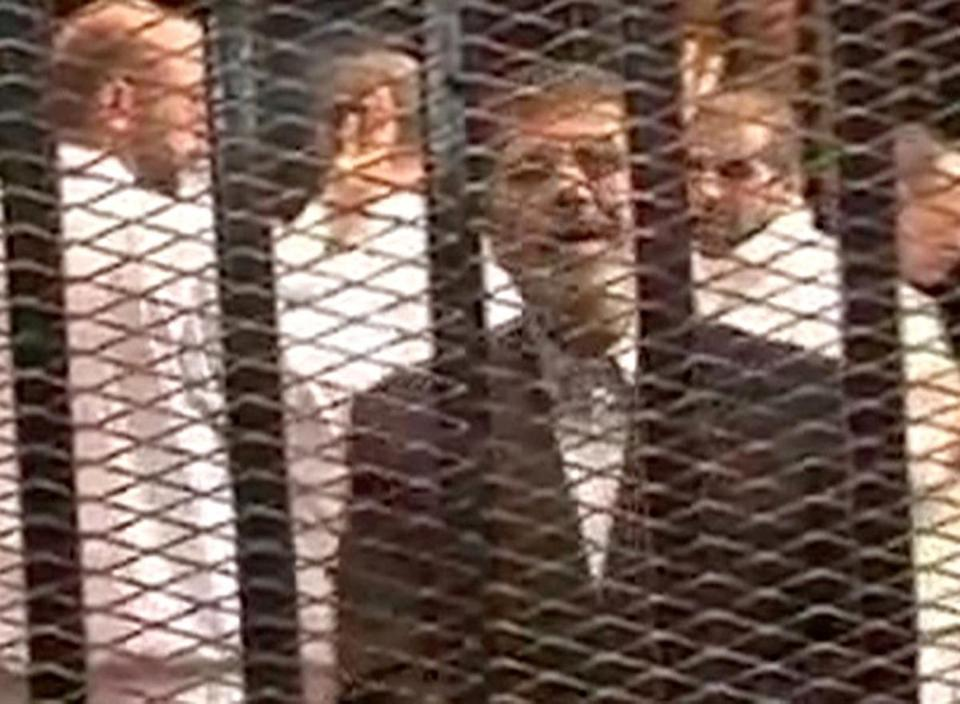 A video image showed Egypt's ousted president, Mohammed Morsi, in the court's cagelike docket.