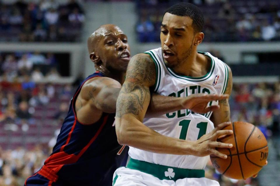 The Celtics' Courtney Lee keeps Detroit's Chauncey Billups away from the ball during the first half.