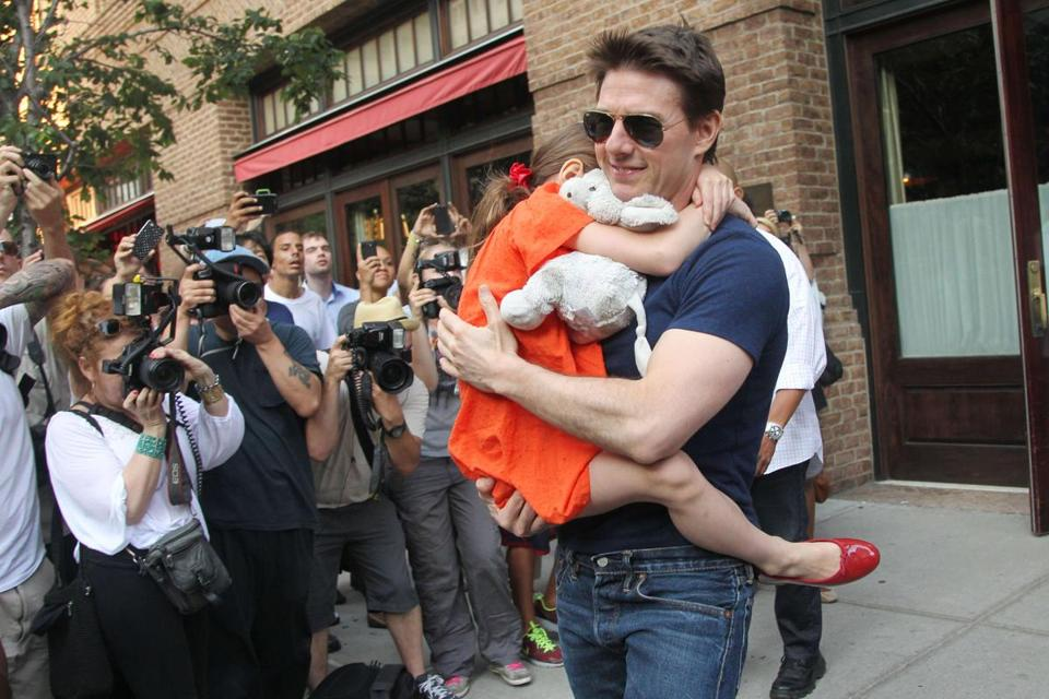 Tom Cruise left his New York City hotel carrying his daughter, Suri, in July 2012.
