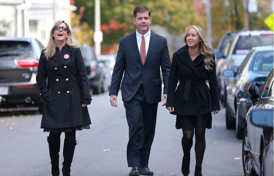 Lorrie Higgins (left) joined Martin Walsh and her daughter, Lauren Campbell, en route to the polls Tuesday.