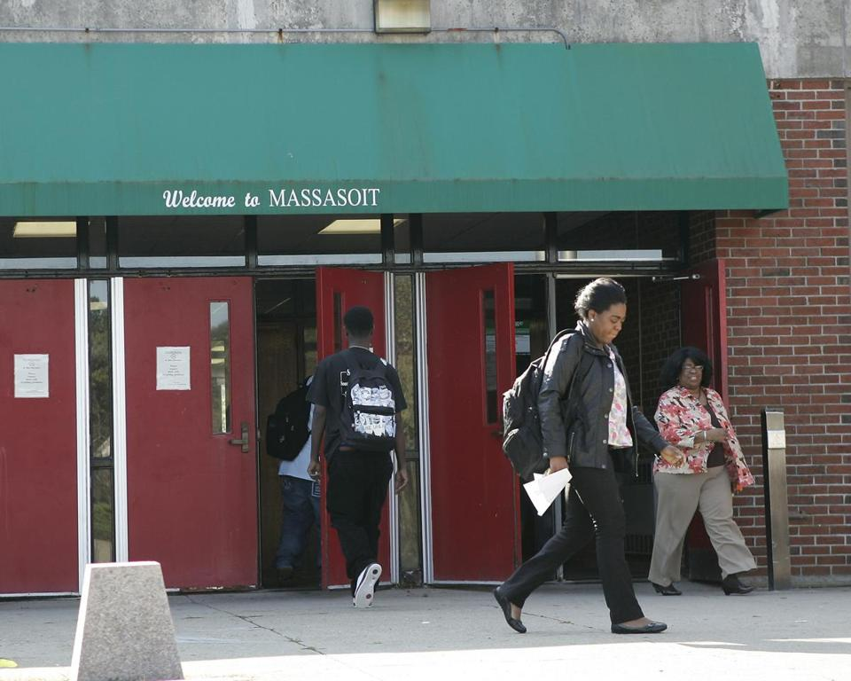 Students exit and enter the Student Union building on the campus of Massasoit Community College in Brockton, Mass