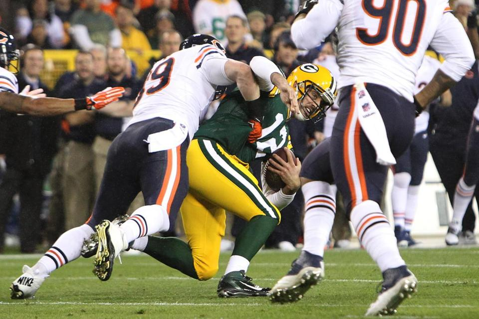 Packers quarterback Aaron Rodgers was hurt Monday on this sack by Shea McClellin.
