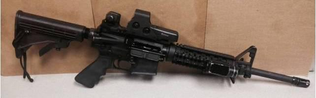 The stolen Colt M16-A1 (above) and HS Precision Pro-Series 2000 Sniper rifles were left in an FBI SWAT vehicle.